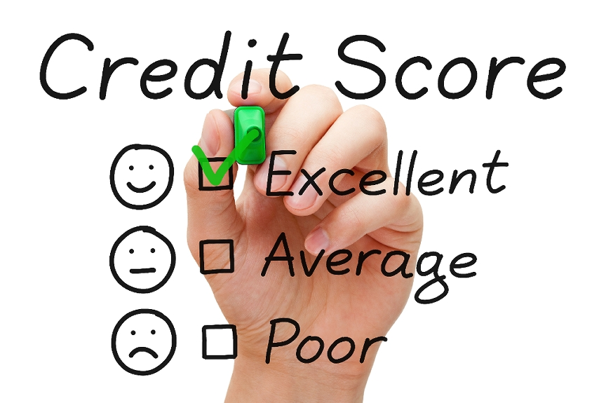 Credit Score text over a picture of a hand checking off a list