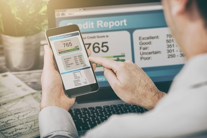 A man pulling his credit report on his cell phone
