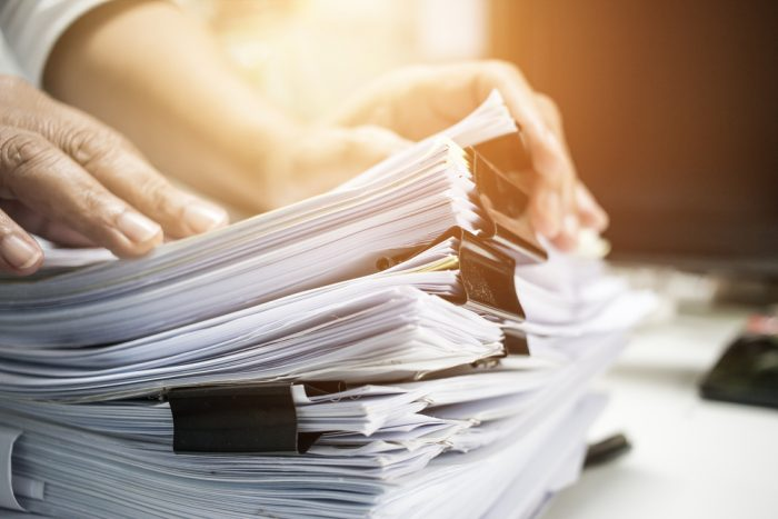 A man going through a stack of papers